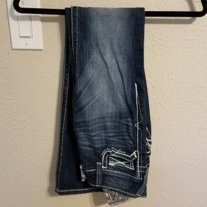 Size 25R mid-rise bootcut Ariat jeans